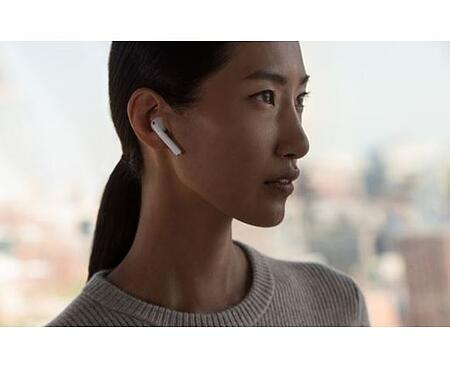 A girl using Airpods